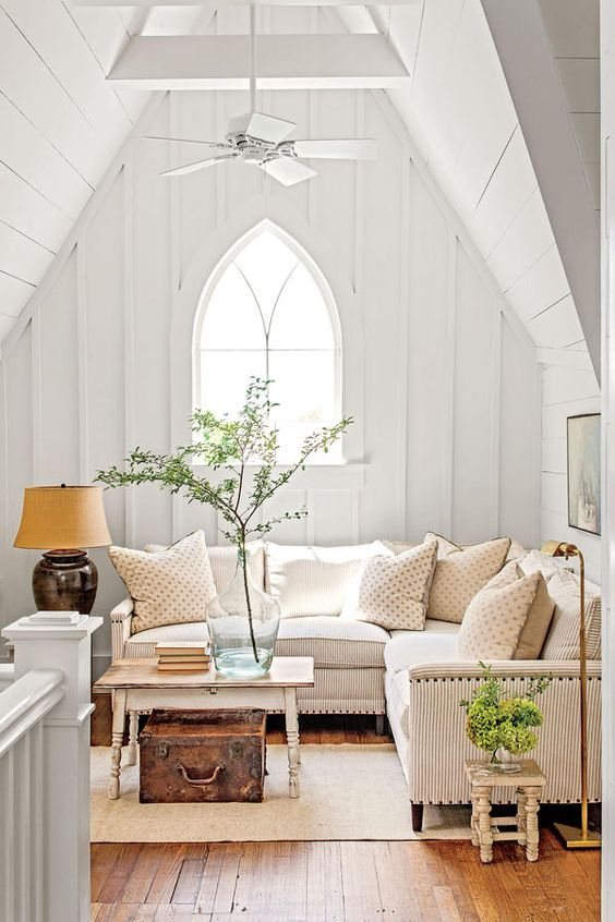 Modern farmhouse living room with gothic details, wood floors, board and batten - found on Hello Lovely Studio