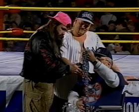 Smoky Mountain Wrestling - Ron Wright presents his famous chain to Dirty White Boy