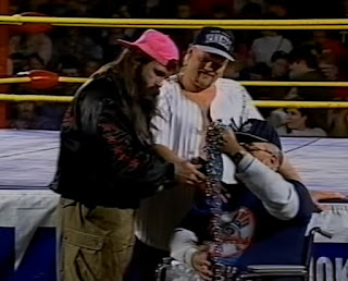Smoky Mountain Wrestling - Ron Wright presents his famous chain to Dirty White Boy