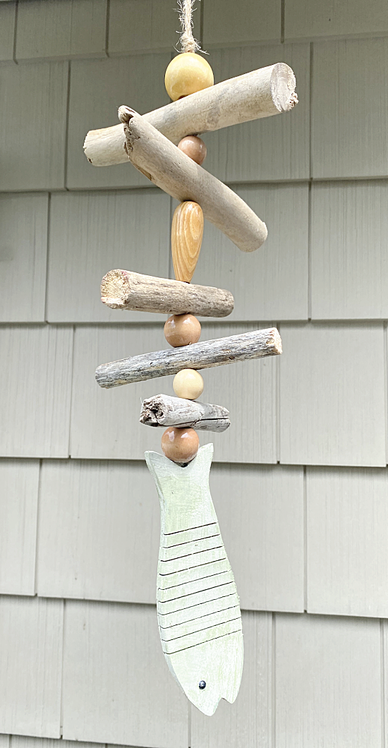 driftwood and bead mobile with a fish