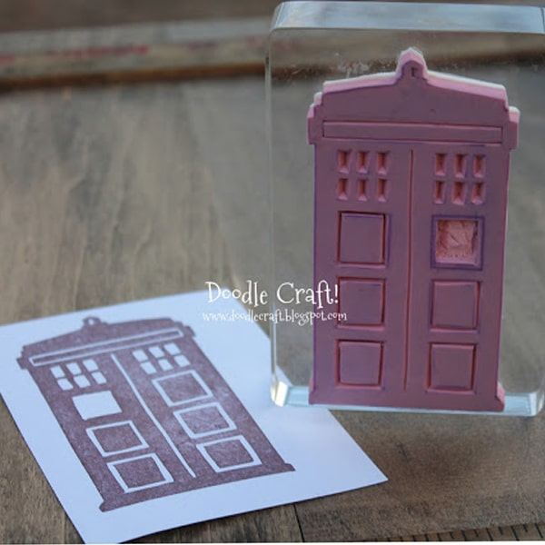 Tardis from doctor who carved out of red rubber to make a stamp.