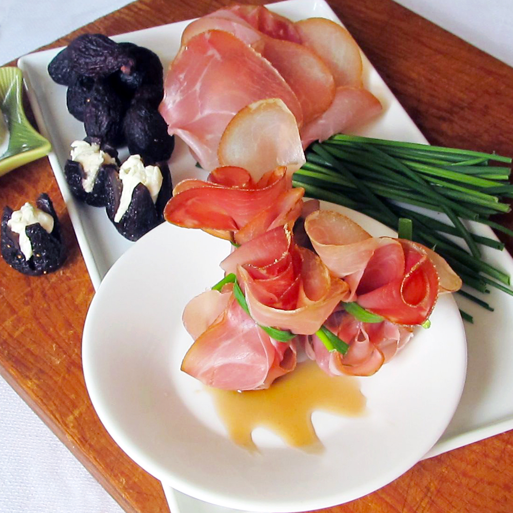 Italian-inspired beggar's purses, a decadent fig, burrata, and prosciutto appetizer.
