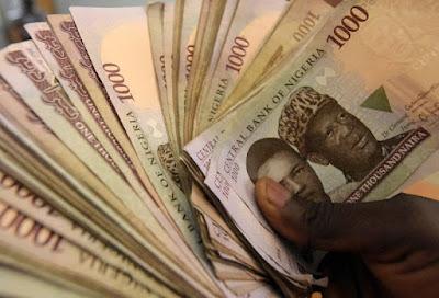 hnd holding naira notes