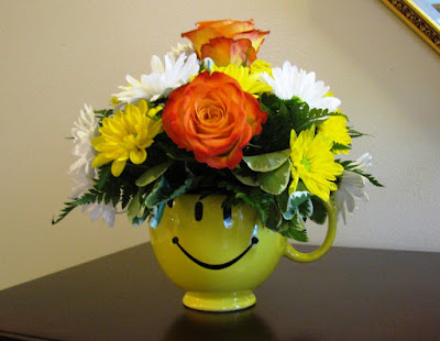 happy face floral arrangement monica curry