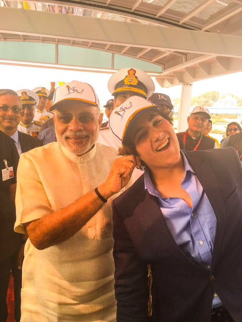"""PM Narendra Modi came across actor Akshay Kumar's son Aarav at Vishakapatnam on Saturday and by habit reached out for his ear.  He also reportedly called Aarav, """"good boy"""".   An adorable picture of a smiling PM pulling Aarav's right ear and the teen in mock pain has emerged."""