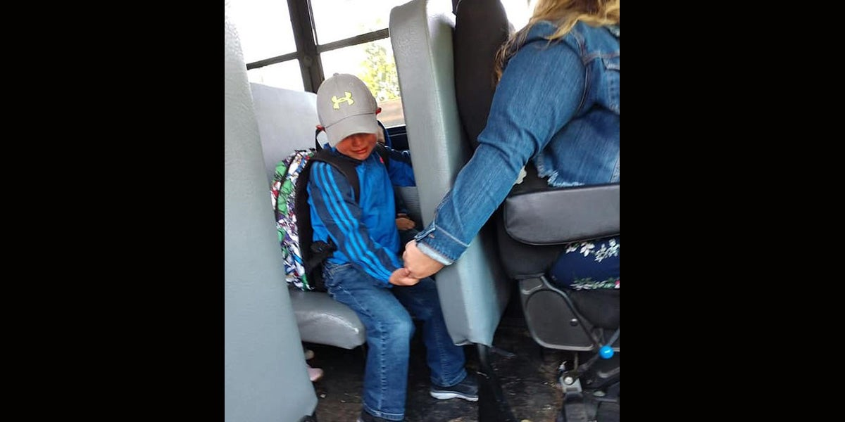 Heartwarming Picture Depicts Kind Bus Driver Comforting Crying Boy On His First Day Of School