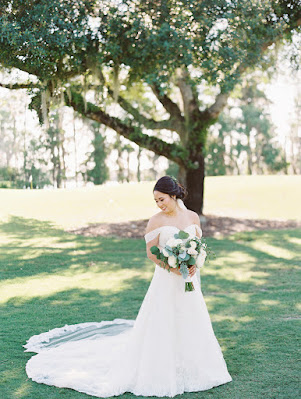 beautiful bride taking photos