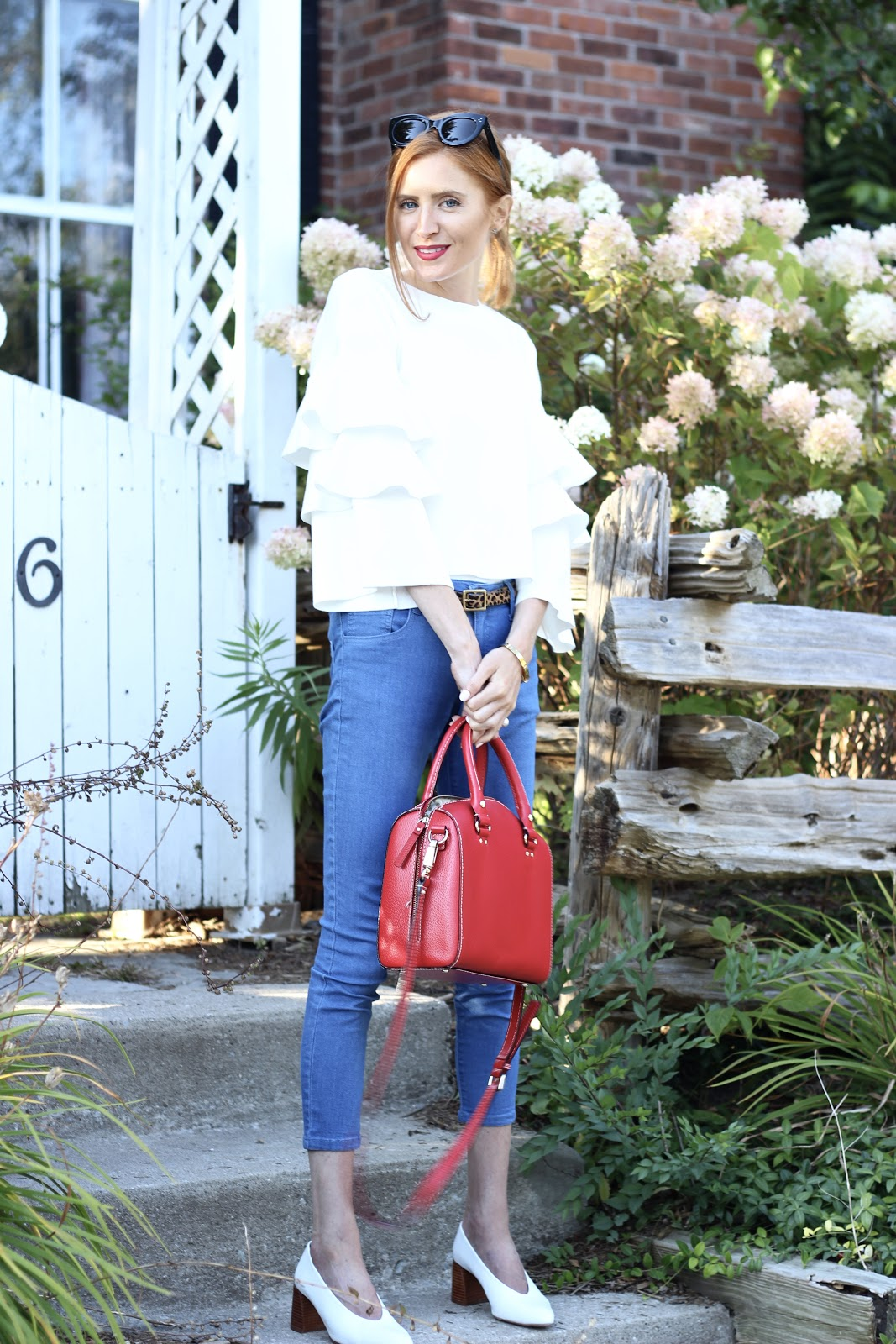 White tiered statement sleeve sweater, blue denim, leopard belt, red bag, paris inspired, White mules