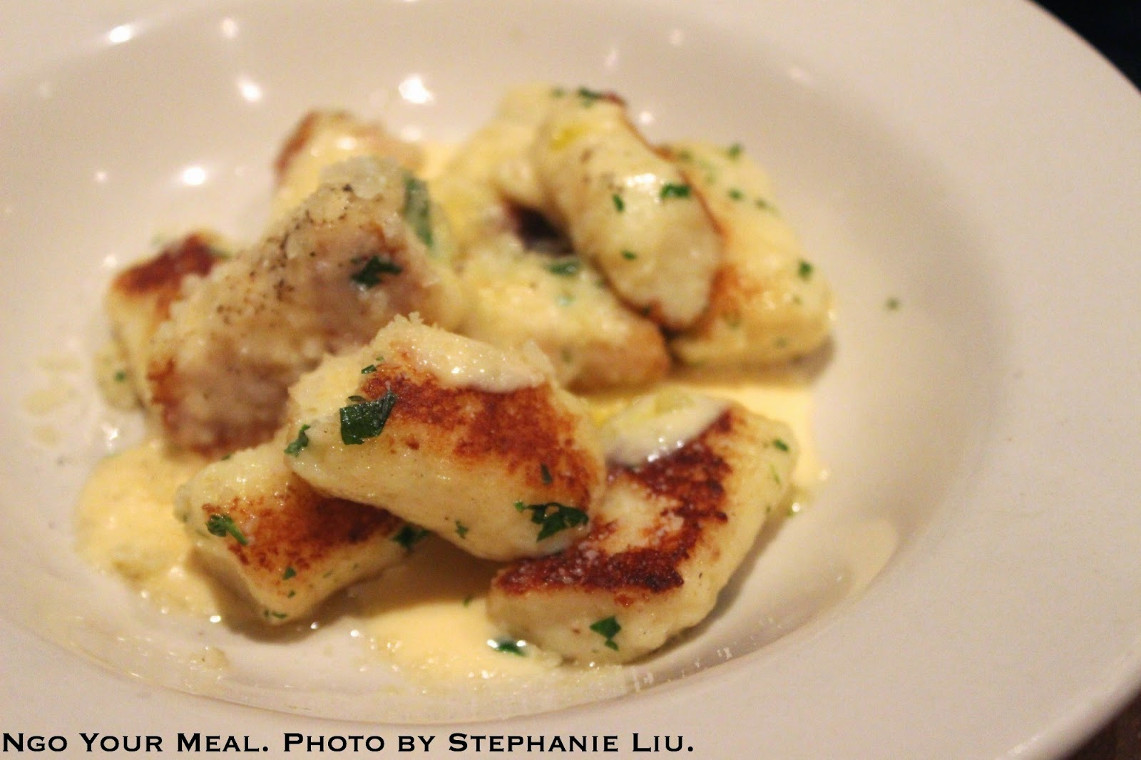 Toasted Ricotta Gnocchi with parmesan, Italian parsley, and white truffle crème at Jane