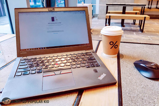 Working in % Arabica Cafe of W City Center, BGC