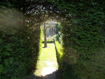 Narrow entrance to a wide open area  A Garden Design Masterclass at Abbey House Gardens