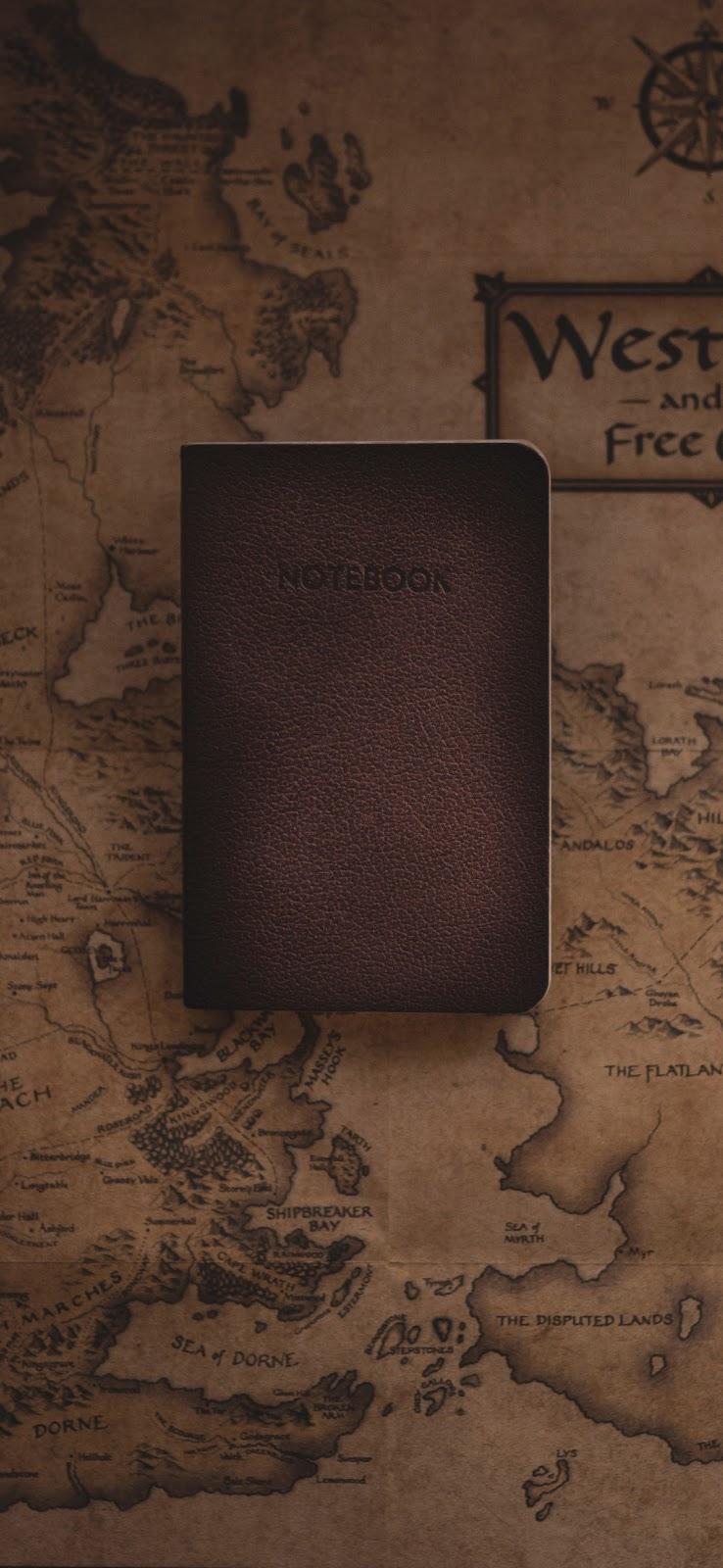 vintage notebook on map wallpaper