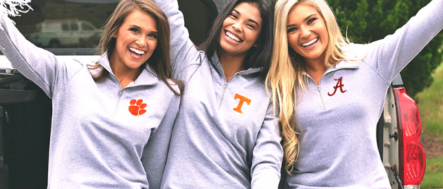 Girls on tailgate with pom poms wearing Marleylilly collegiate pullovers