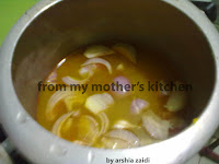 kali masoor daal  with ingredients in pressure cooker