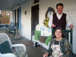 inn owners on front porch