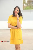Actress Poojitha Stills in Yellow Short Dress at Darshakudu Movie Teaser Launch .COM 0071.JPG