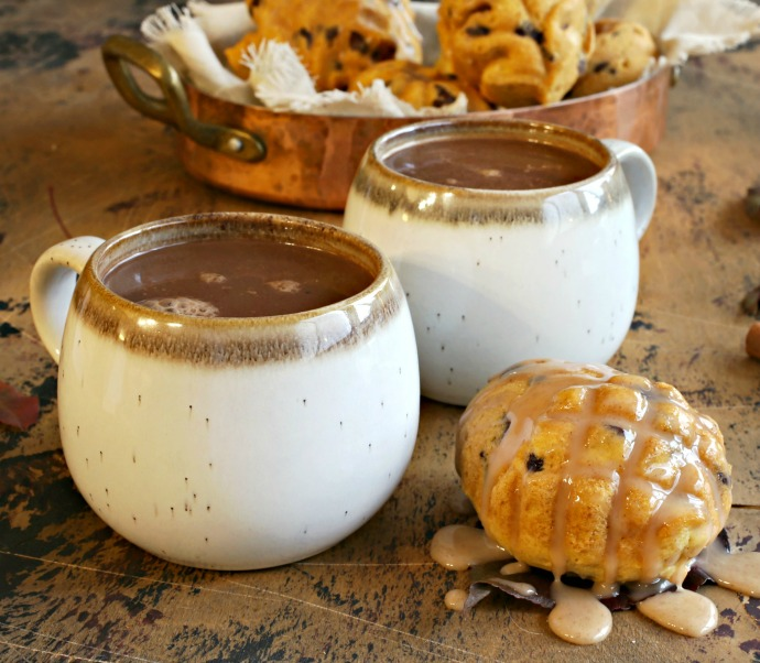 Recipe for pumpkin and chocolate chip snack cakes, topped with a cinnamon glaze and served with pumpkin and cinnamon hot cocoa.