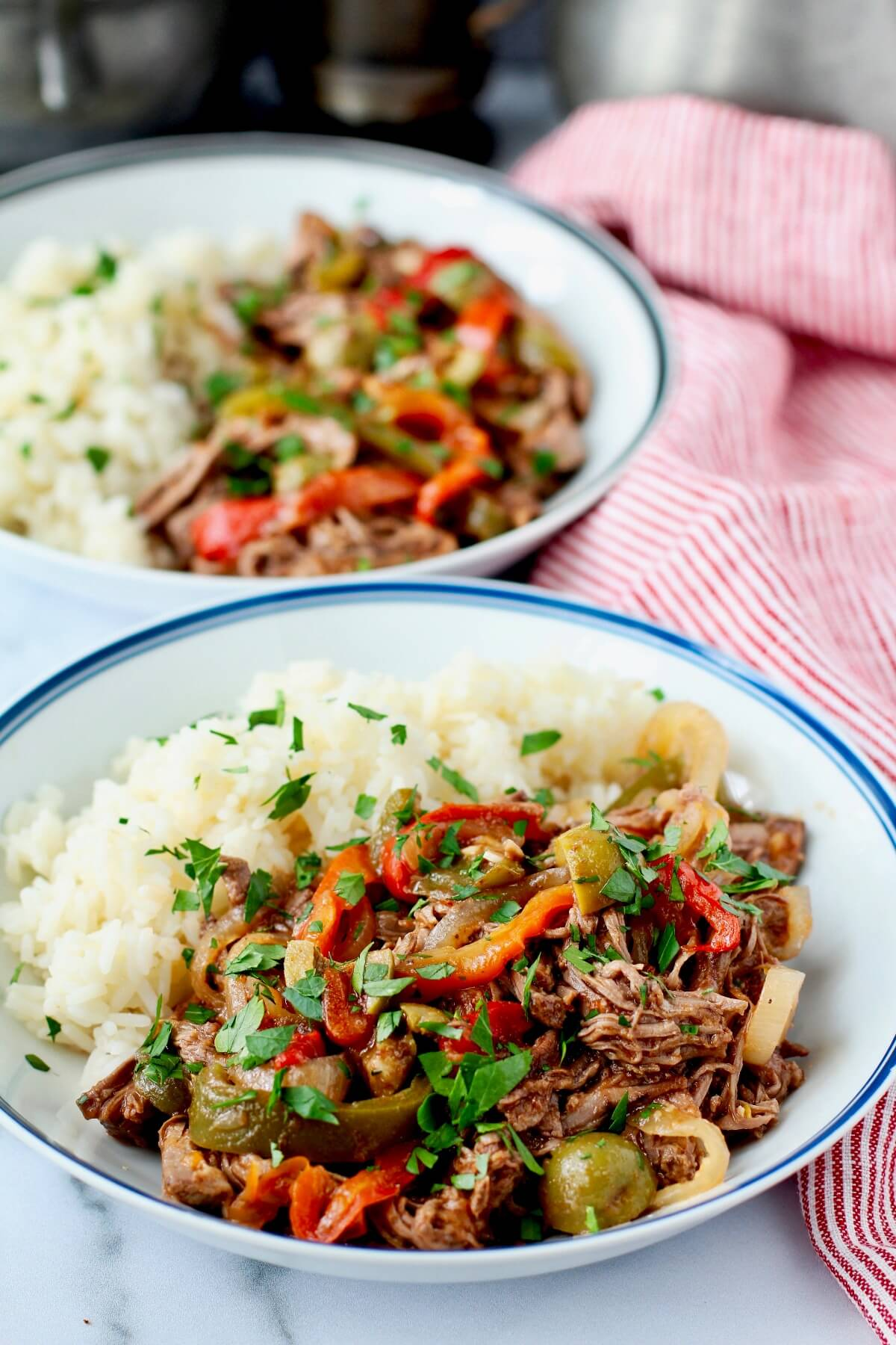 Ropa vieja with peppers and olives