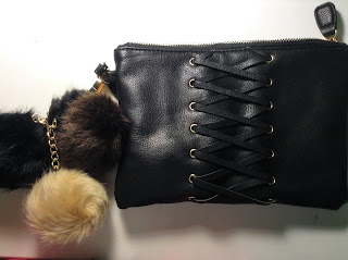 black lace up clutch