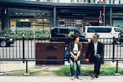 Man and woman sitting on bench Photo by Andrew Leu on Unsplash
