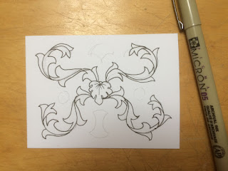 Acanthus scrolls inked over pencil guidelines on card