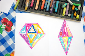 """""""Painting"""" with oil pastels to create beautiful """"crystal"""" sun catchers with kids"""