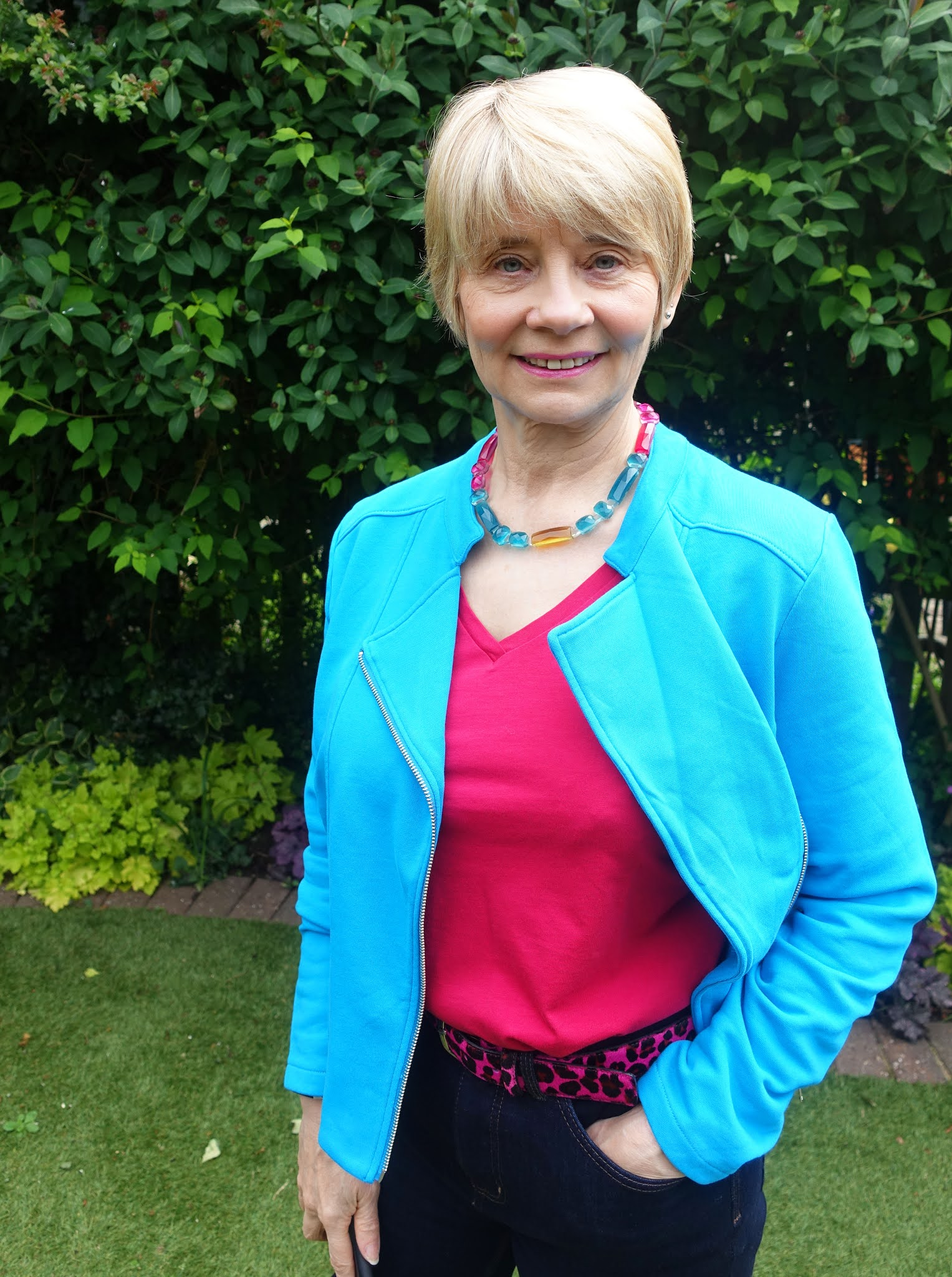 Gail Hanlon from Is This Mutton the over 50s style blog in Blue Jewel jacket and sangria t-shirt from Kettlewell Colours