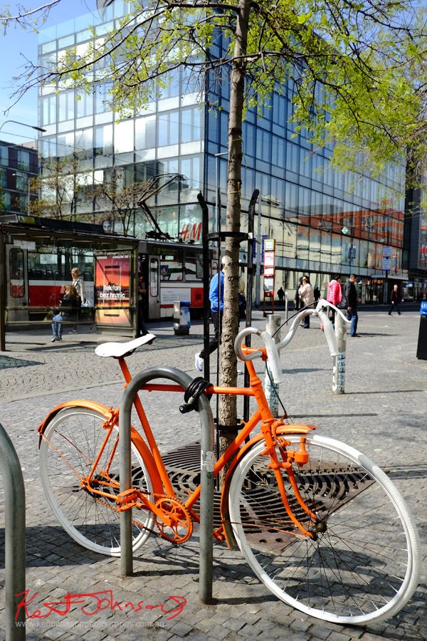 An Orange Bicycle in Prague at Malá Strana. Photo by Kent Johnson.