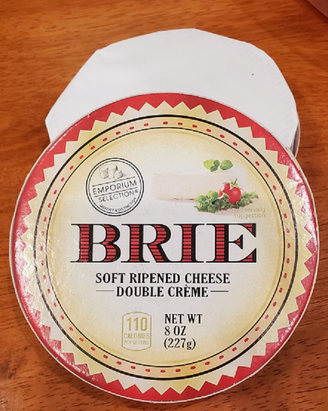 this is a block of round Brie Cheese in the container