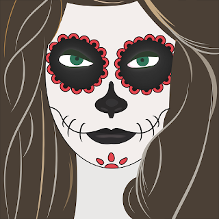 Woman wearing a painted Day of the Dead skull face.