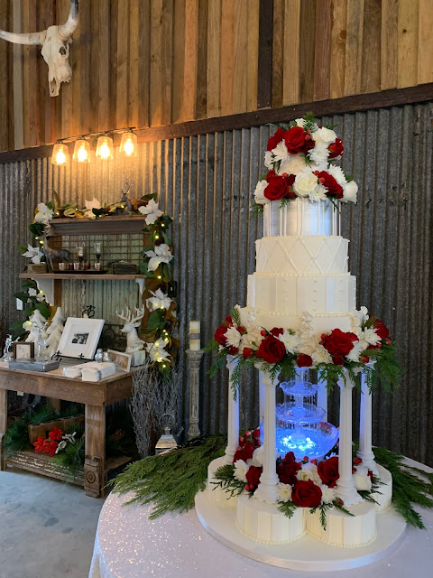 The Bride's Cake was a multi-level cake including a fountain and fresh flowers