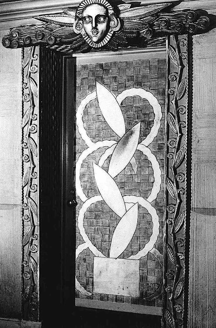 an ornate metal door, 1920s photograph?