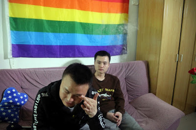 Sun Wenlin (right) sits with his partner, Hu Mingliang