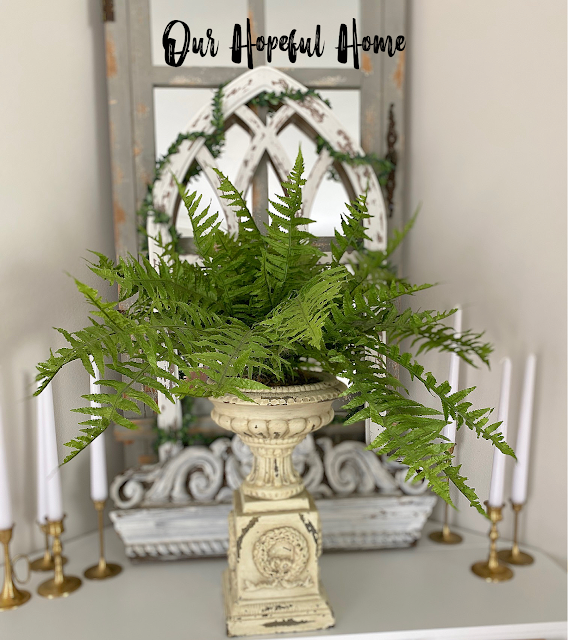 green fern plant urn fireplace mantel decor