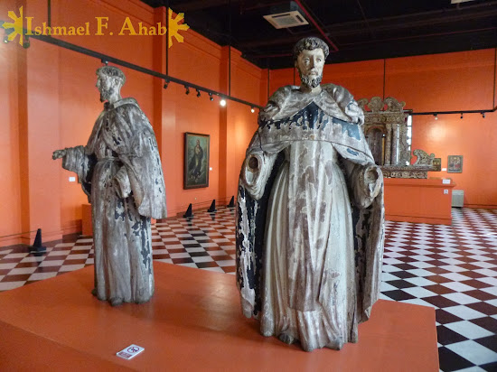 Old statues of Saint Francis and Saint Dominic in the Philippine National Museum