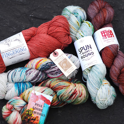 Pile of hand dyed prize yarn!
