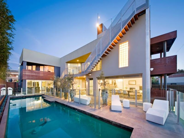 Photo of modern home as seen from the pool area in the backyard