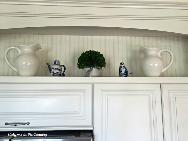 Blue and white accessories in white kitchen