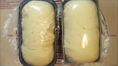Bread dough rising in bread loaf pans.