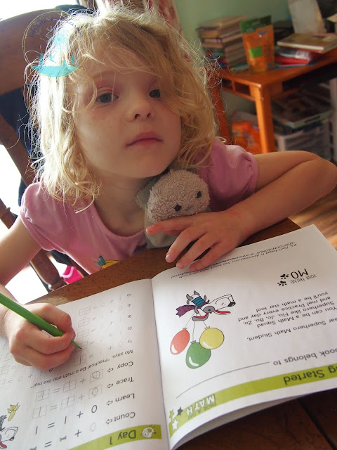Kindergartner ready to work on addition skills with Page A Day Math
