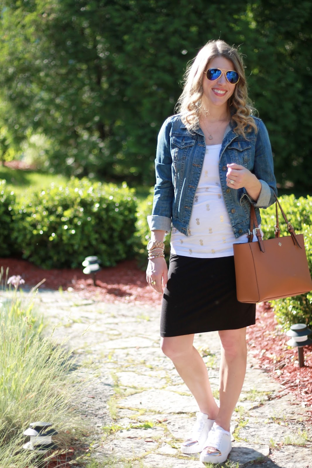 white pineapple print tank, denim jacket, black maternity pencil skirt, white rose gold tennis shoes, Tory Burch Tote