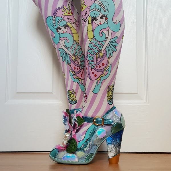 lucite heeled shoes being worn with mermaid print tights
