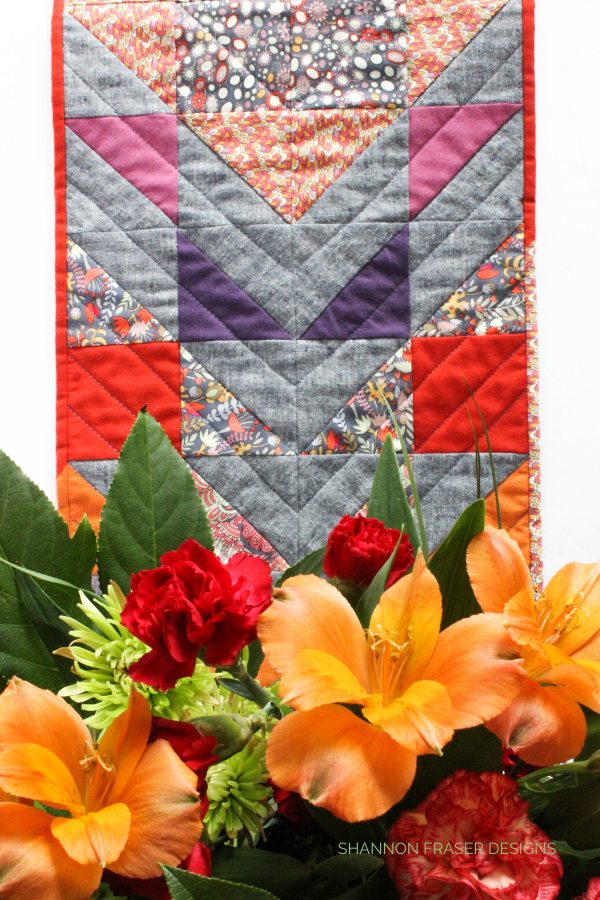 Fantasy Modern Aztec  Quilted Table Runner | Modern Home Décor | Shannon Fraser Designs #tablerunner #quiltedtablerunner #quilting #halfsquaretriangles