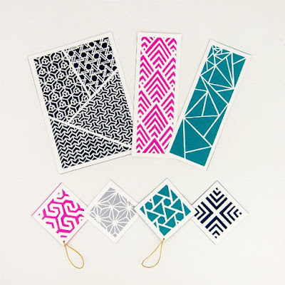magenta, silver, teal, and navy paper cut gift tags, bookmarks, and art piece