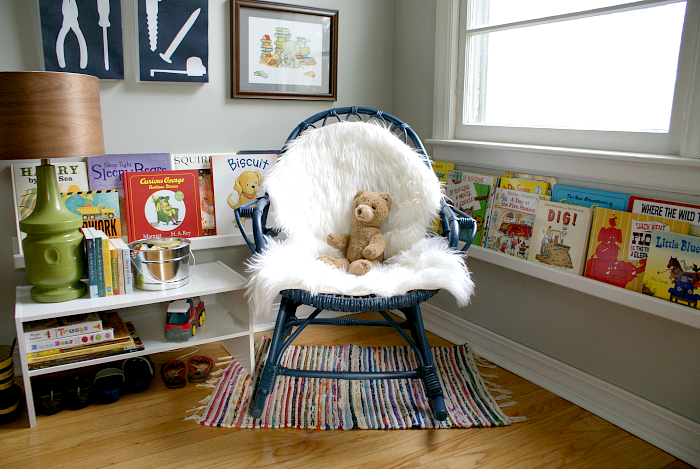 Boy's room reading nook with rocker and book ledges