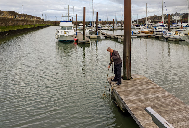 Photo of Phil checking the prawn pot