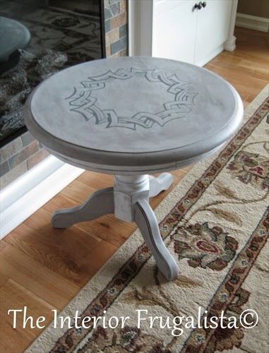 Round pedestal table After with painted medallion graphic