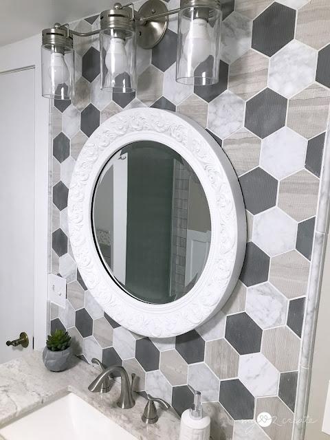 new vanity with tile backsplash