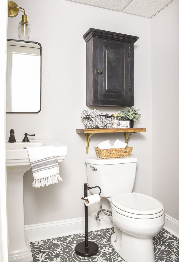 Vintage modern bathroom makeover in black and gray