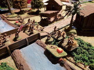 Japanese attackers swarm over the bridge